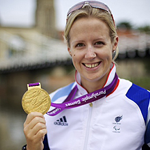 Our patron Naomi Riches holding her Gold Medal